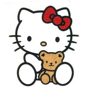 Hello Kitty wearing red bow holding teddy bear Iron On Transfer for T